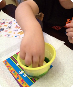 toddler dyeing eggs