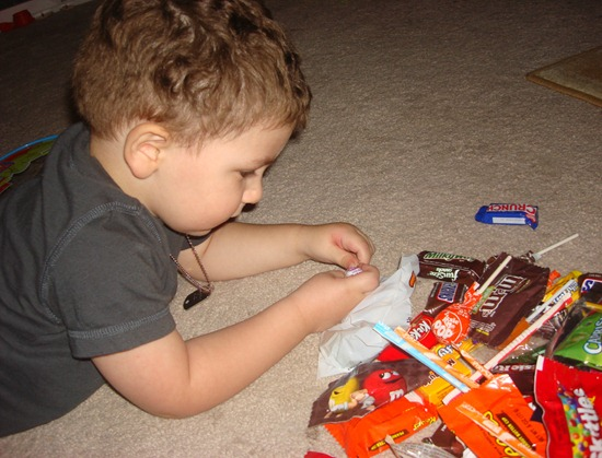 toddler with candy haul halloween