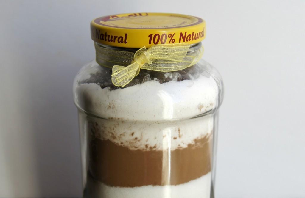 Recycled Ragu jar turned into brownies in a jar