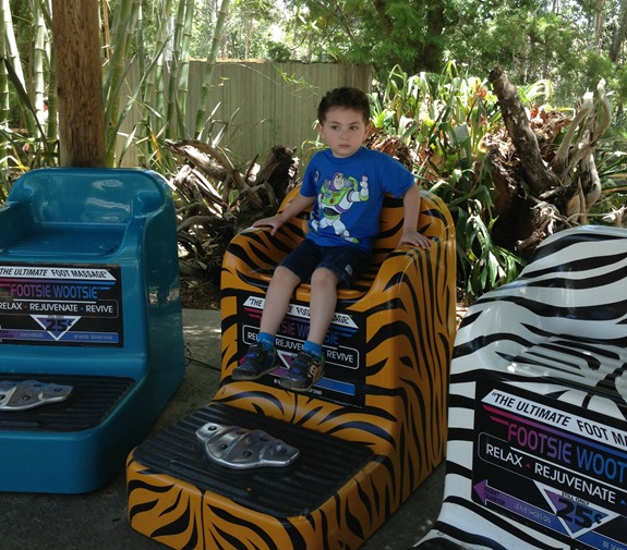 Shane posing on foot massager at San Diego Zoo Safari Park