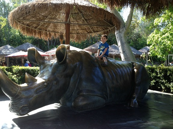 Shane posing on giant rhino statue at San Diego Zoo Safari Park