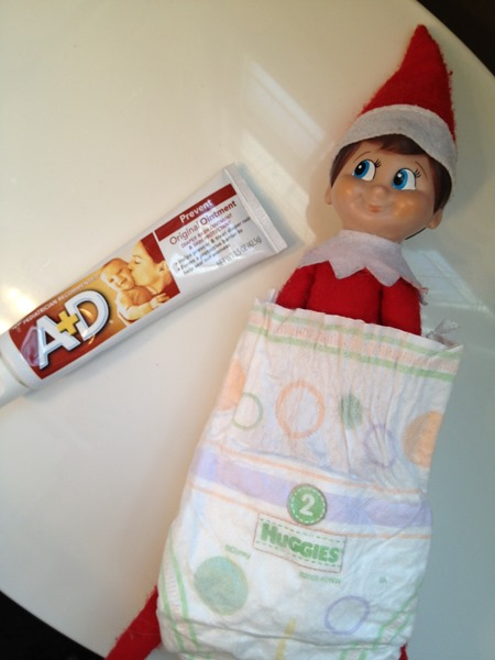 Elf on the Shelf trying to get a diaper change