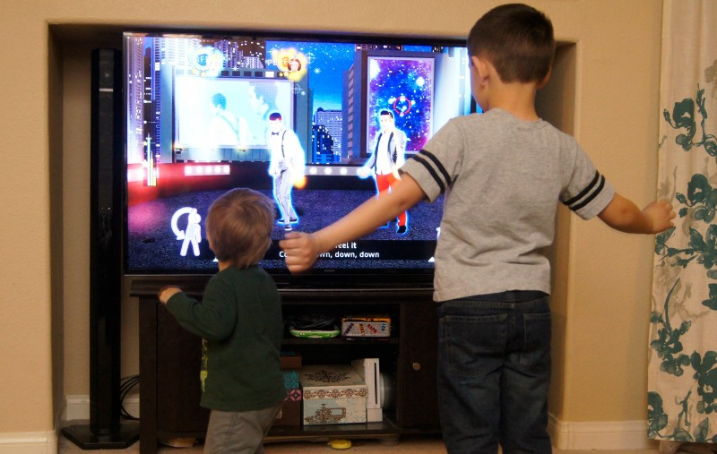 Brothers playing Just Dance Disney Party 2