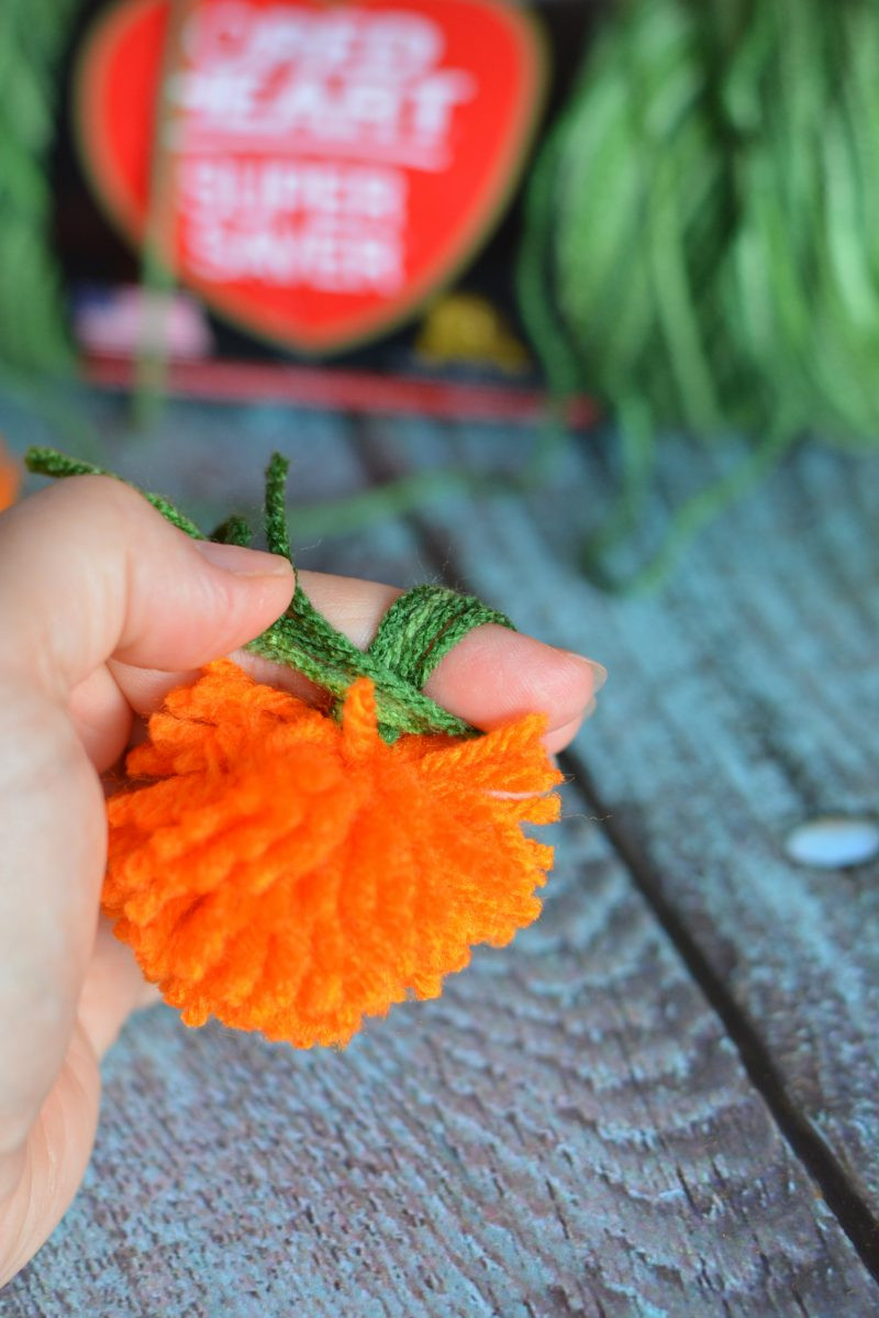 I love decorating my home with pumpkins because they work for both fall and Halloween- so they can stay up even longer! These DIY No Sew Yarn Pumpkins are so cute and so versatile- you can use them to make an easy pumpkin garland, use them in other crafts or projects, or just use them as decorations as they are!