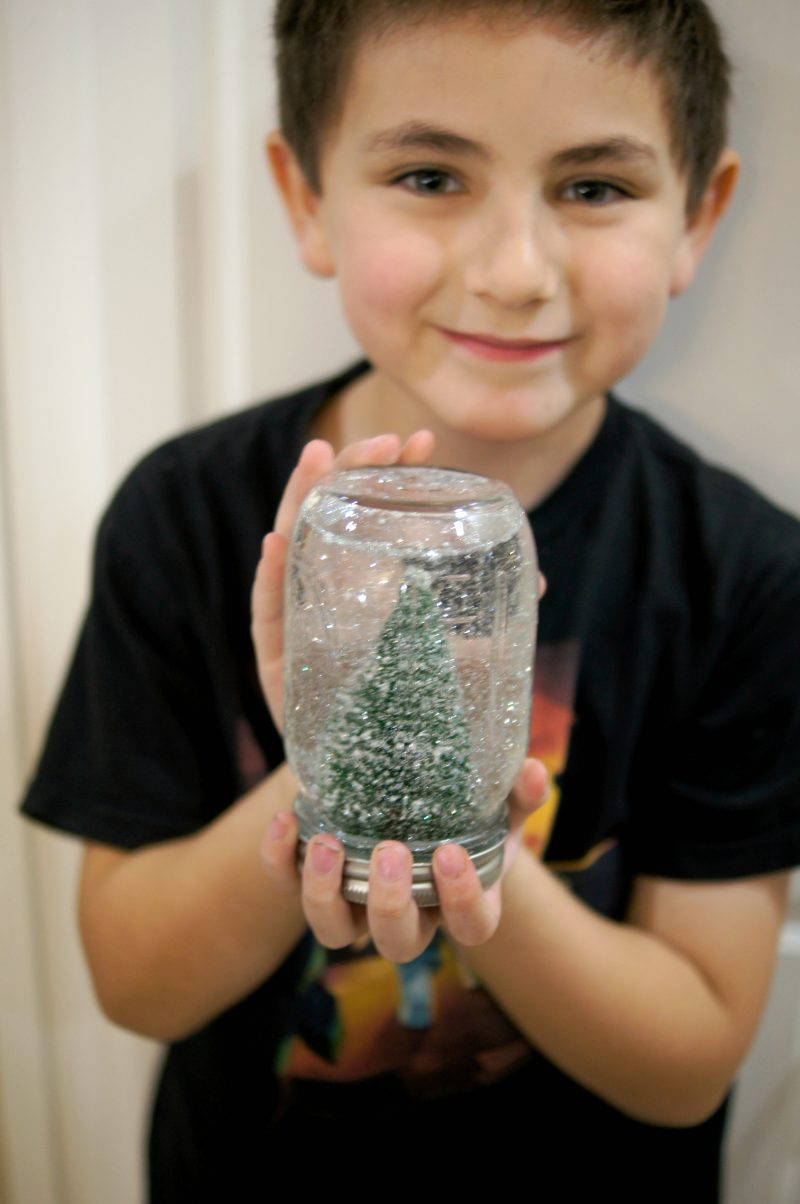 Christmas crafts don't have to be hard! This easy DIY Snowglobe lets you use whatever cute decoration you want, along with a mason jar and some Krazy Glue, to make your own unique, homemade creation!