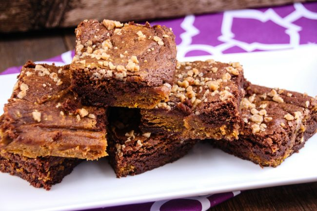 After a long day at the pumpkin patch, there's nothing more rewarding then making a pumpkin puree and baking some homemade Chocolate Pumpkin Swirl Brownies from scratch! Add this chewy brownie recipe to your Halloween must-bake list alongside pumpkin bars and pumpkin pie!
