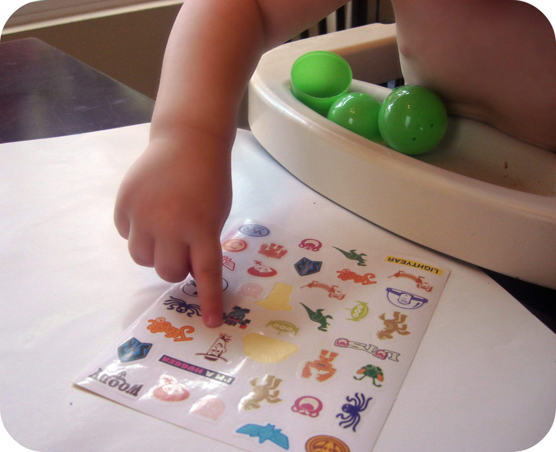toddler choosing stickers from toy story