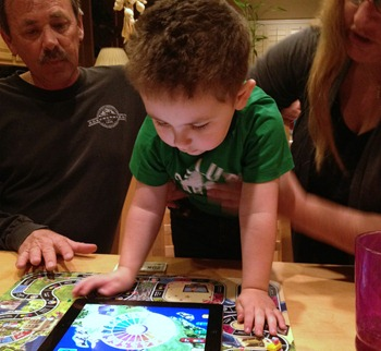Toddler playing The Game of Life zAPPed