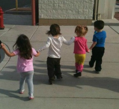 toddler friends holding hands