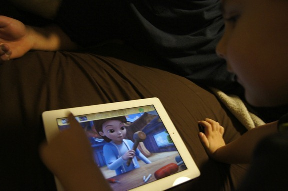 kid playing ipad game