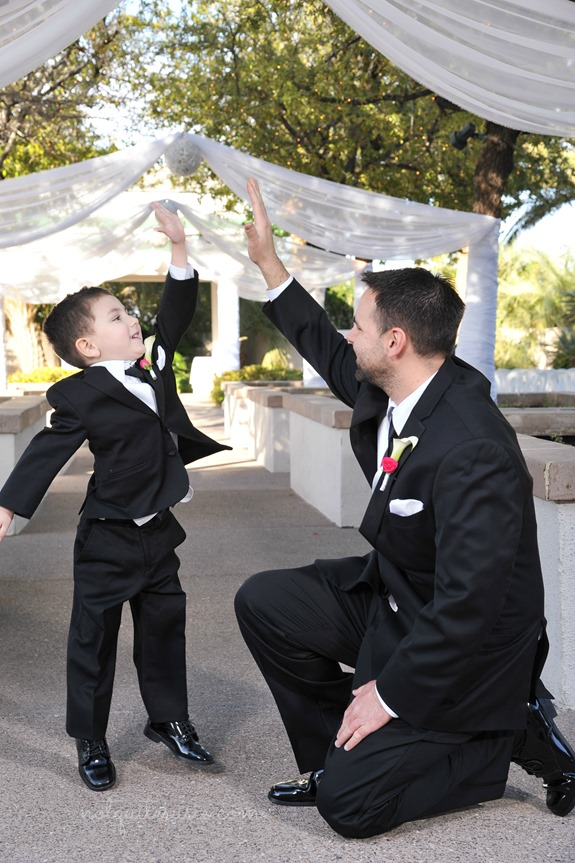 Dad and son high fiving at wedding