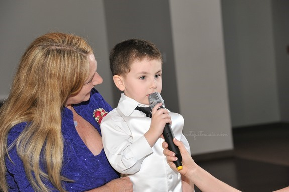 Son giving toast at wedding