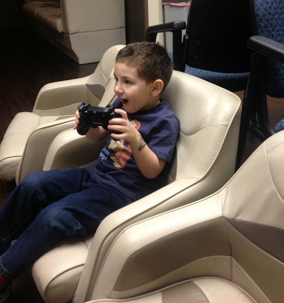 Kid playing Playstation