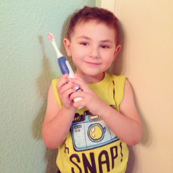 Shane holding a Sonicare PowerUp toothbrush