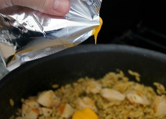 Adding Velveeta Cheese Sauce #CookinComfort #shop