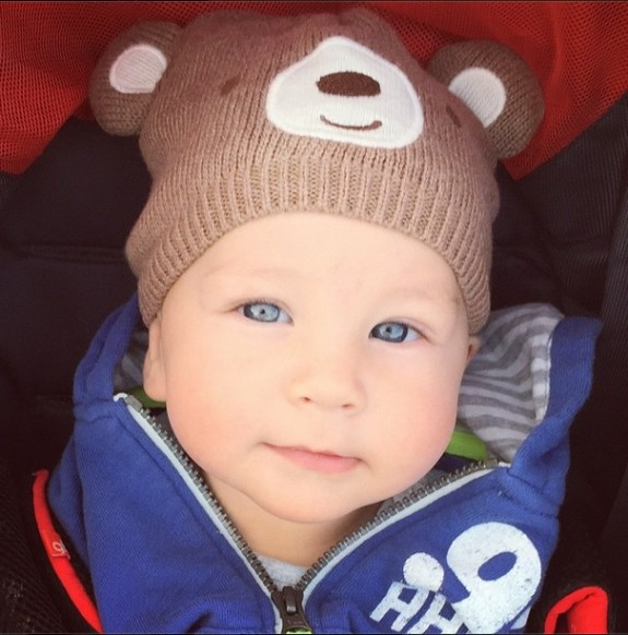 Zac in stroller with bear hat