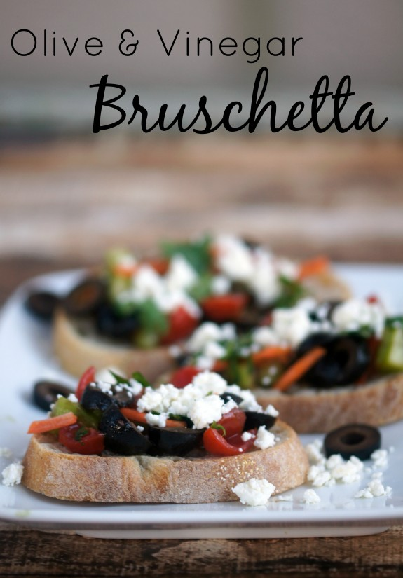 Olive and Vinegar Bruschetta- a quick and easy appetizer recipe featuring olives, balsamic vinegar, and red wine vinaigrette as the not-so-secret ingredient!