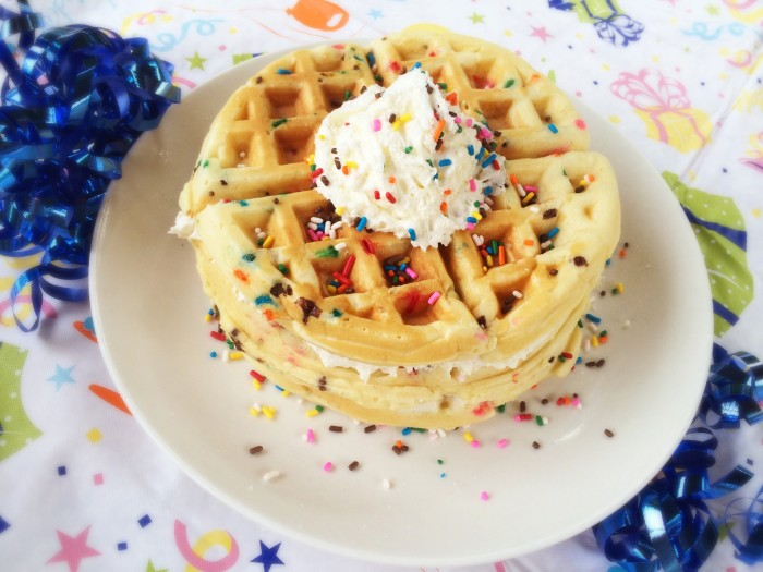 Every birthday needs a special celebration recipe- why not start the day off with these easy homemade Birthday Cake Waffles? They have the perfect toppings- whipped cream and sprinkles!- and they're so pretty!