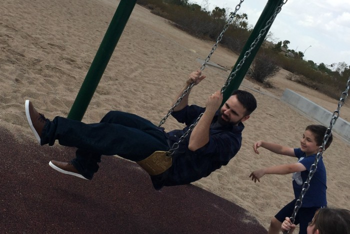Shane pushing Justin on the swing