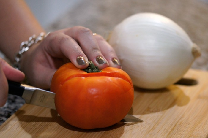 Cutting tomatoes with Calphalon Self-Sharpening Knives