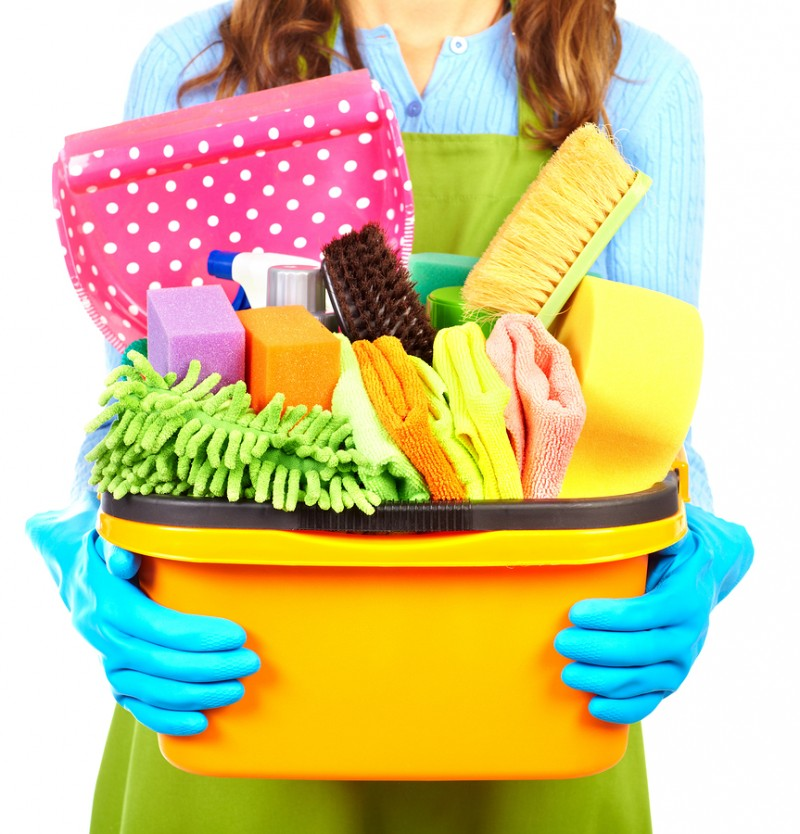Maid hands with cleaning tools. House cleaning service concept.