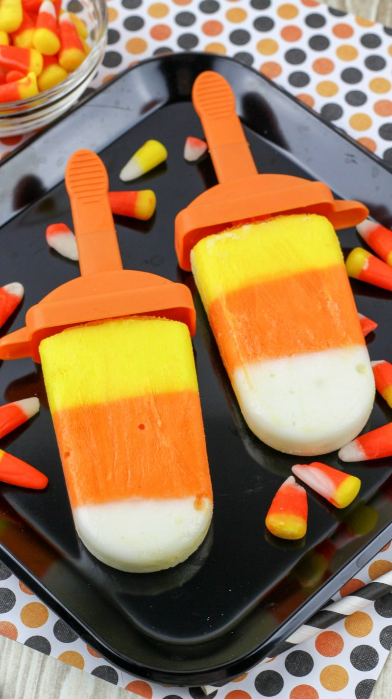 These Candy Corn Yogurt Pops are an easy, delicious way to get your fix of one of the best kinds of Halloween treats! These ice pops taste like desserts but are actually healthy, and are an easy recipe to enjoy- no baking required!