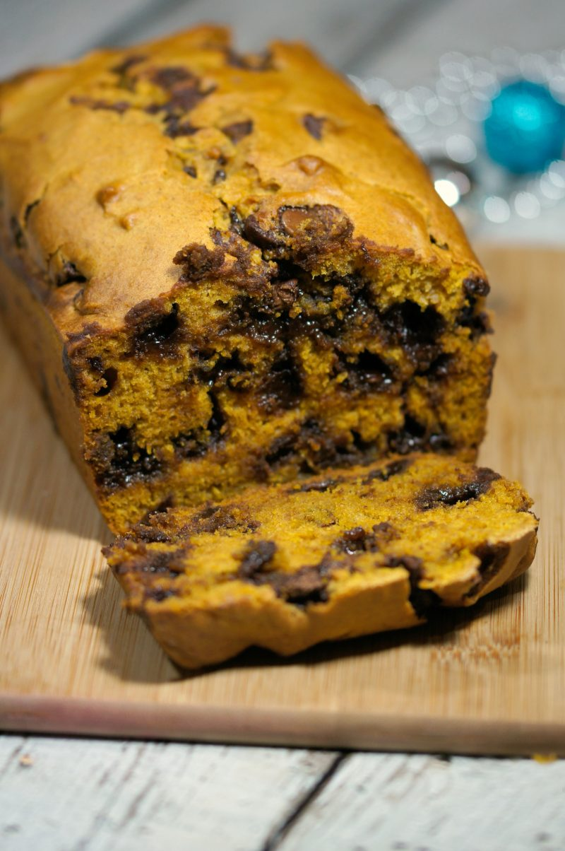 Need an idea for a great recipe to bake and gift this Christmas? Look no further- this easy recipe is for the best, most incredibly moist Pumpkin Chocolate Chip Bread! Totally loaded with chocolate chips, this bread will satisfy even the sweetest sweet tooth.