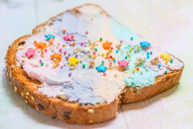 Who else is loving all this fun Unicorn Food lately? Check out these recipes and ideas and learn how to make your own DIY unicorn food for a kids unicorn party or just because! Everything from savory toast to healthy snacks to sweet desserts are covered. Get ready for lots of tie dye and rainbow and of course, some magic!