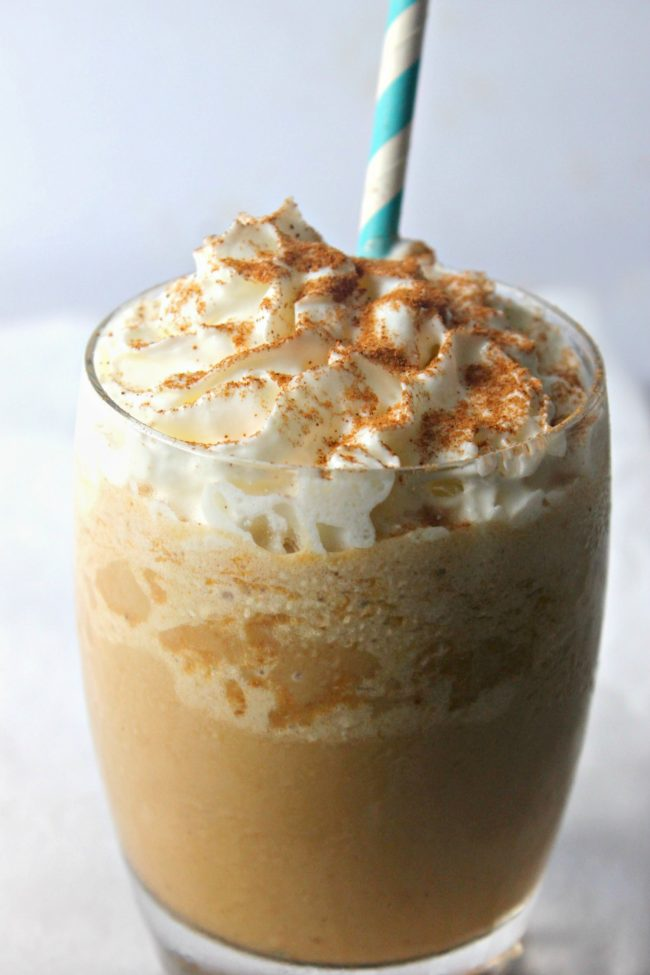 Tis the season for the famous PSL- Pumpkin Spice Lattes! But what do you do when it's still too warm outside for hot coffee? You DIY it with a Homemade Pumpkin Spice Frappe! This cold iced beverage is so easy to make and you can even use syrup to make it a little closer to Paleo. {There's still milk though, but you could always substitute!} Skip the long line at Starbucks and make this in your fridge overnight!