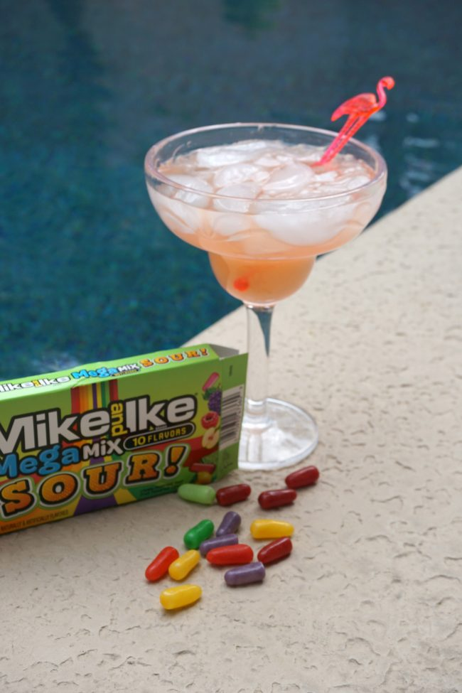 Looking for a delicious, family-friendly and super fun mocktail to serve at your next summer party? These Strawberry Lemonade Mocktails are made from Mike And Ike candy and are so easy to make! Strawberry Lemonade not your thing? Use this same recipe to make your own flavor combinations using your favorite candy flavors! #MegaSourSummer #ad