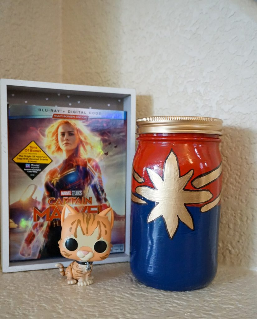 Who doesn't love the Captain Marvel movie inspired by the comics? Brie Larson was totally kicking butt and Goose is the cutest Flerken ever- we need some Goose memes! In the meantime, you can make this DIY Homemade Captain Marvel Logo Jar Vase!