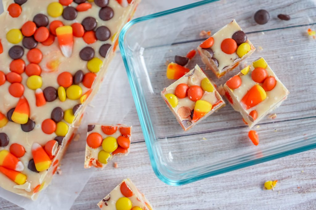 Homemade fudge is a delicious Christmas tradition- but you can make it for other holidays too, like Halloween! This easy White Chocolate Candy Corn Fudge recipe is perfect for fall and even has some peanut butter in the form of Reese's Pieces.