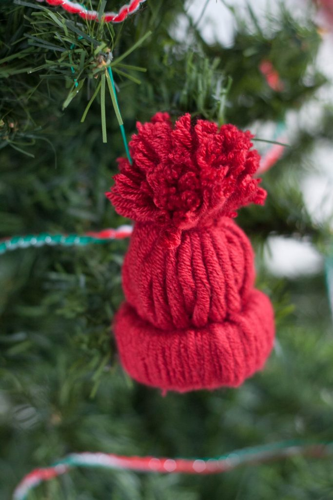 Love making unique and personalized handmade ornaments with your kids? This easy rustic DIY winter hat ornament is adorable and so fun to make for Christmas!