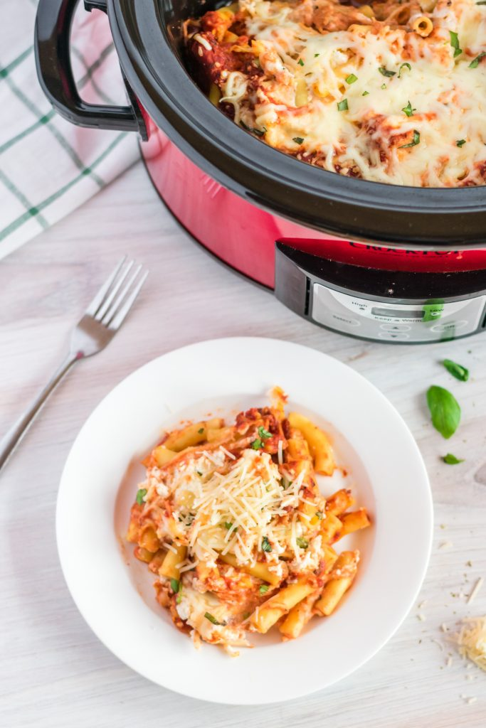 Is there anything more comforting than a delicious, warm Baked Ziti with Ricotta? This Slow Cooker Baked Ziti recipe is made using a crockpot so it's ready when you are, and best of all it's super easy! This version is Vegetarian, but if you're not into meatless you can always add to it!